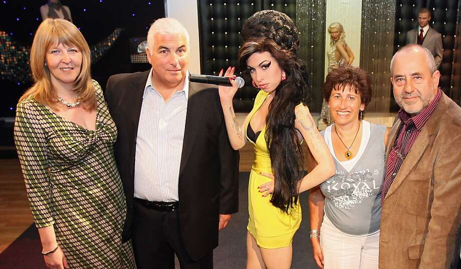 Amy Winehouse's family including father Mitch Winehouse (CL) and mother Janis Winehouse (CR) unveil a waxwork figure of Grammy Award winning singer Amy Winehouse at Madame Tussauds on July 23, 2008 in London, England.  (Photo by Dan Kitwood/Getty Images) Photo: Dan Kitwood, Getty Images