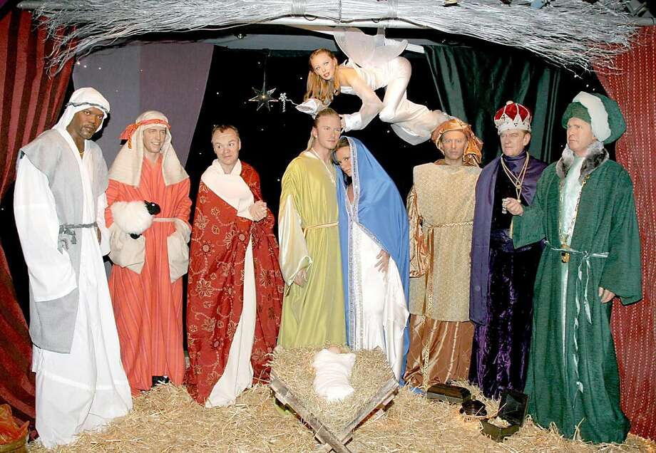 Madame Tussauds' Christmas Nativity scene featuring David Beckham and Victoria Beckham as Joseph and Mary, Tony Blair, George Bush and The Duke of Edinburgh as the Three Wise Men, co-starring Hugh Grant, Samuel L Jackson and Graham Norton as the Shephers and Kylie Minogue as The Angel. The display can be seen at Madame Tussauds in London. (Photo by Fred Duval/FilmMagic) Photo: Fred Duval