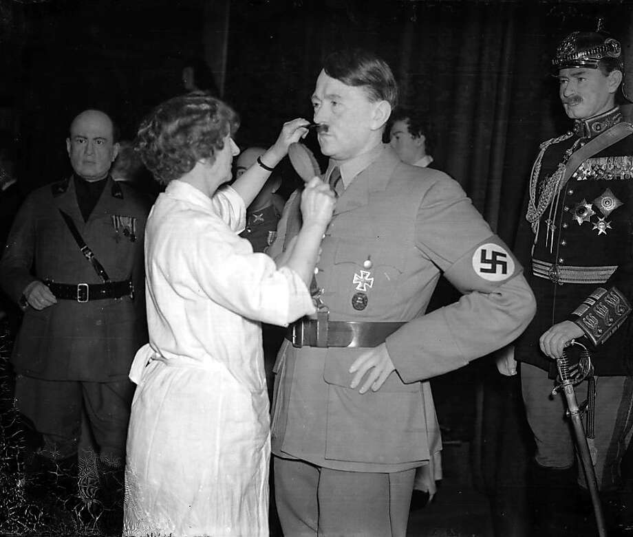 24th November 1938, London, England, A wax model of German Chancellor and Nazi dictator Adolf Hitler has his moustache combed by a Madame Tussauds hairdresser at the famous London waxworks  (Photo by Popperfoto/Getty Images) Photo: Popperfoto