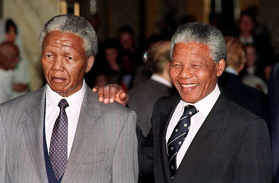 (FILES) South African anti-apartheid leader and African National Congress (ANC) member Nelson Mandela (r) looks 25 April 1991 in London at a new wax portrait figure of himself at famous Madame Tussauds Waxworks. (Photo credit should read JOHNNY EGGITT/AFP/Getty Images) Photo: Afp, AFP/Getty Images