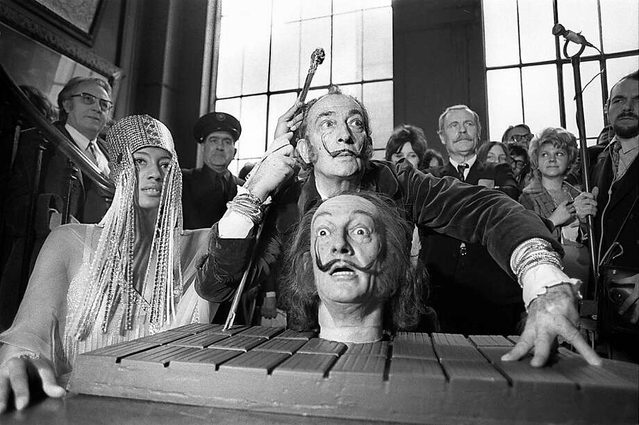 "PARIS, FRANCE - APRIL 1:  A picture dated 01 April 1971 shows Spanish painter Salvador Dali, one of the most popular painters of the 20th century, during the presentation of his waxwork portrait at the Gustave Moreau Museum in Paris. Exhibitions to mark the centenary of the birth of Catalan artistic colossus Salvador Dali will open this week with Barcelona hosting as its first offering ""Dali, culture for the masses"". == B/W ONLY ==AFP PHOTO FILES  (Photo credit should read STF/AFP/Getty Images) Photo: Stf"