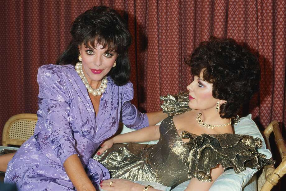 English actress Joan Collins poses with her waxwork double, 1989. (Photo by Tom Stoddart/Getty Images) Photo: Tom Stoddart Archive