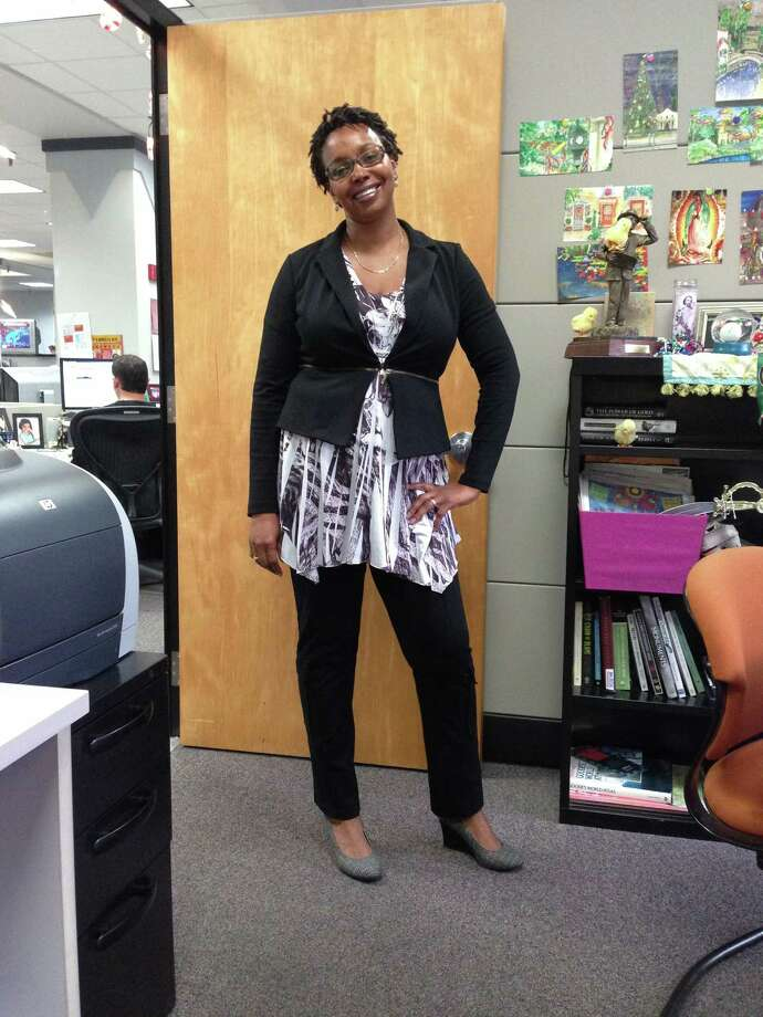 Work appropriate does not have to mean boring. Express-News staffer Chantay Warren pulls off a cropped jacket over a flowing top - a hard proportion to master. The tie-dye adds some zing, and the darker pieces work to keep that in balance. Finished off with discreet gray wedges, and this is a look that can go from conference room to happy hour in a flash.  - Emily Spicer Photo: Emily Spicer