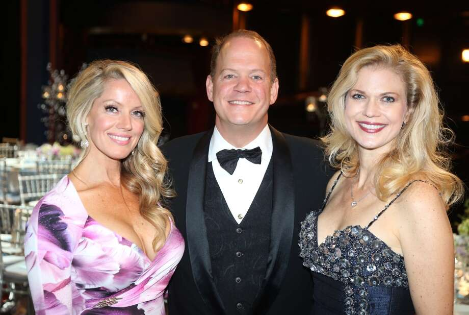 From left to right, Melissa Edwards, Amy Pierce, and Rob Pierce during the cocktail hour at the Hobby Center for Theatre Under The Stars silent auction in Houston, Texas.