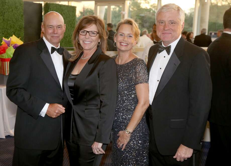 From left to right, Ernie Danner, Jackie Danner, Becky McAndrews and Bart McAndrews during the cocktail hour at the Hobby Center for Theatre Under The Stars silent auction in Houston, Texas.