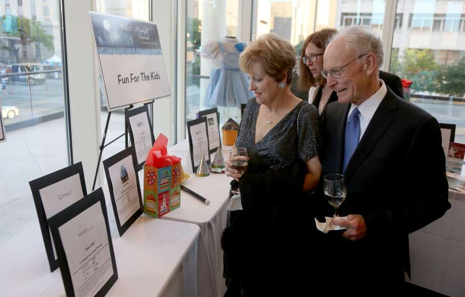 From left to right, Becky McAndrews and Sig Cornelius during the cocktail hour at the Hobby Center for Theatre Under The Stars silent auction in Houston, Texas.