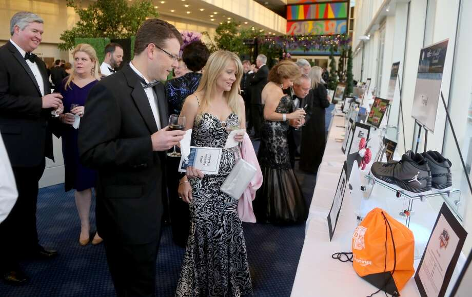 From left to right,Bryan and Michelle Bulawa during the cocktail hour at the Hobby Center for Theatre Under The Stars silent auction in Houston, Texas.