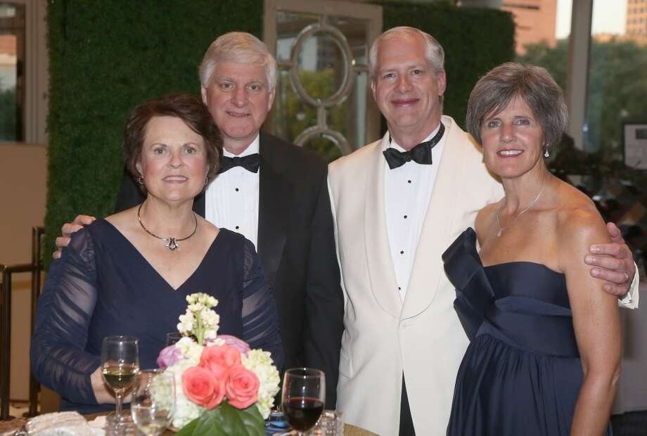 From left to right, Joann Allspach, Gene Allspach, Mike White and Sue White during the cocktail hour at the Hobby Center for Theatre Under The Stars silent auction in Houston, Texas.