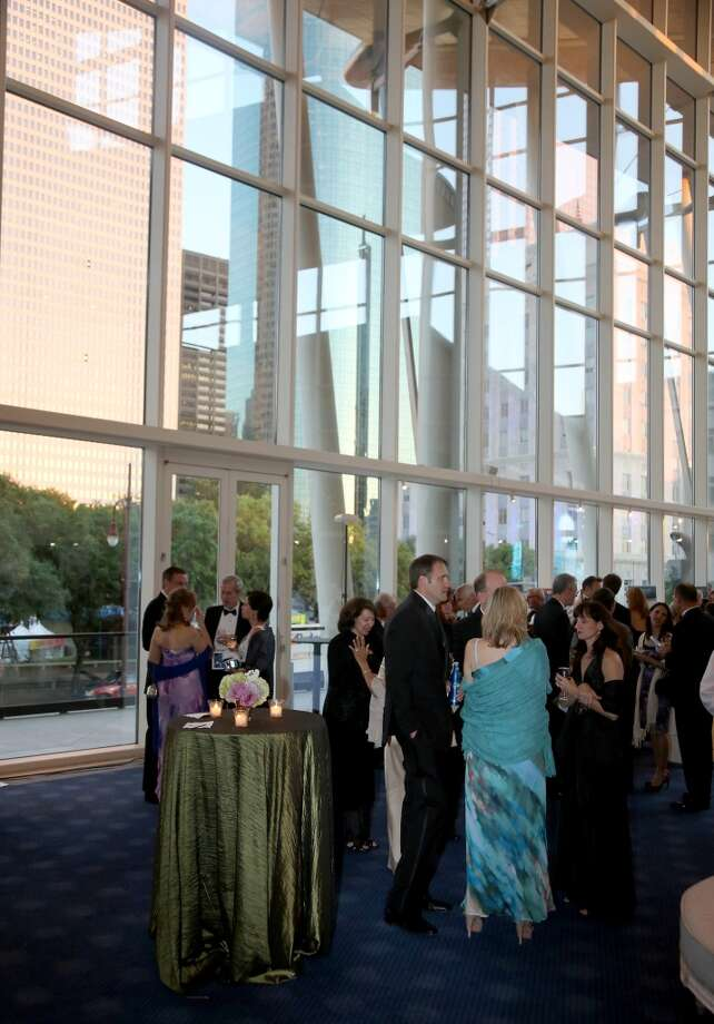 General scene during the cocktail hour at the Hobby Center for Theatre Under The Stars silent auction in Houston, Texas.