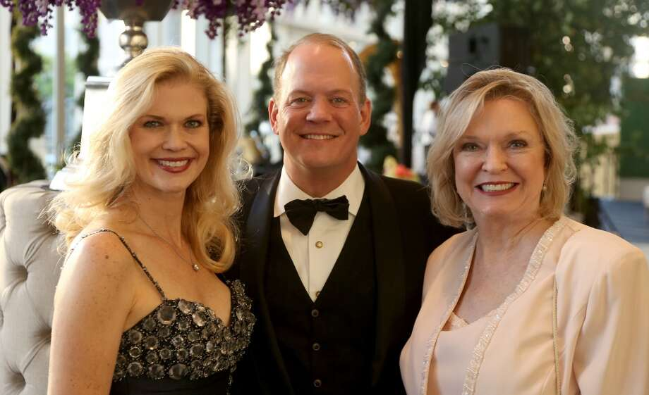 From left to right, Amy Pierce, Rob Pierce, Carolyn Gough during the cocktail hour at the Hobby Center for Theatre Under The Stars silent auction in Houston, Texas.