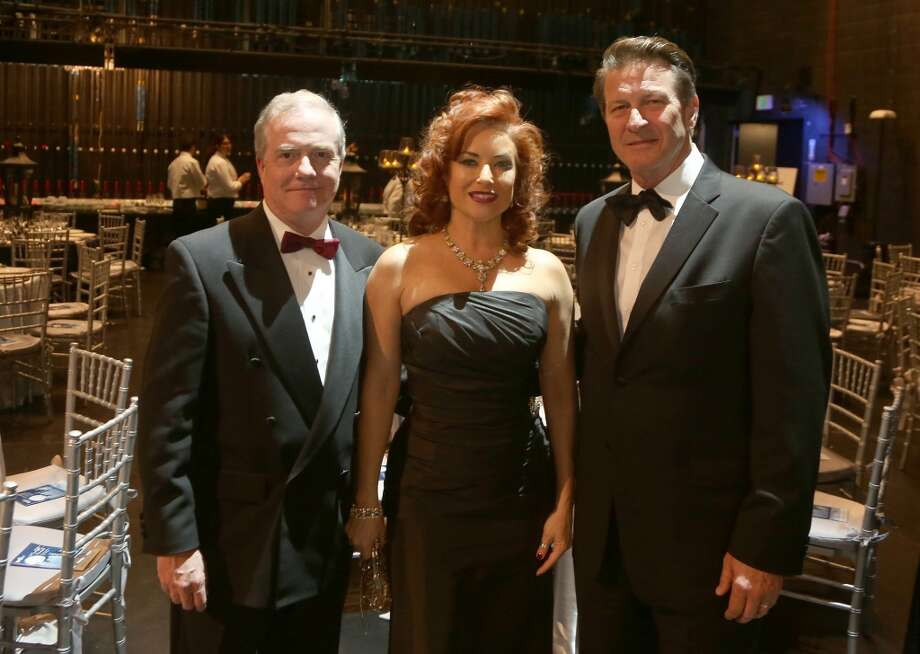 From left to right, John Breckenridge, Michelle Breckenridge, Brett Cullen during the cocktail hour at the Hobby Center for Theatre Under The Stars silent auction in Houston, Texas.