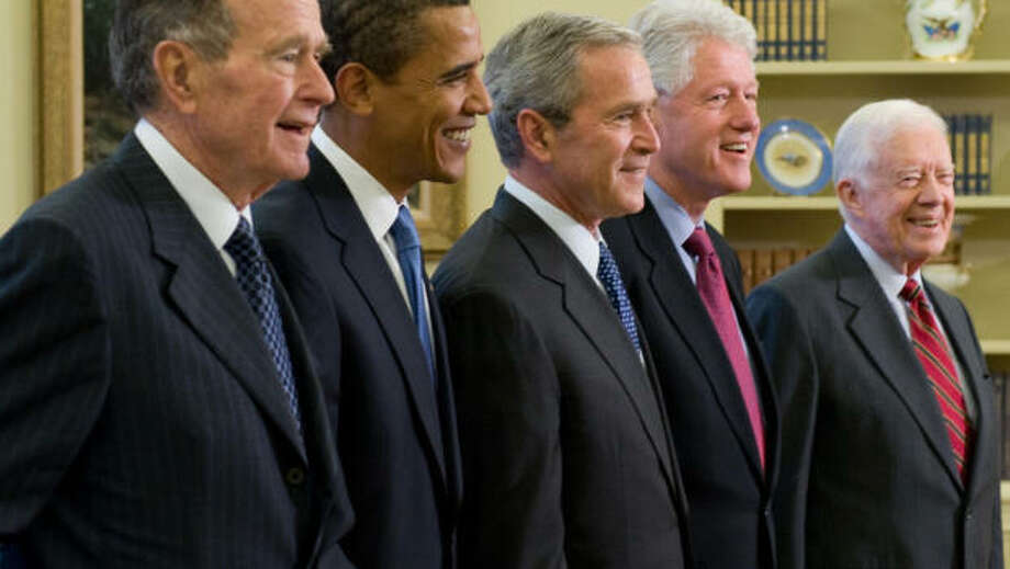 George W. Bush with former presidents George H.W. Bush, Bill Clinton, Jimmy Carter, and President Obama. Getty Images.