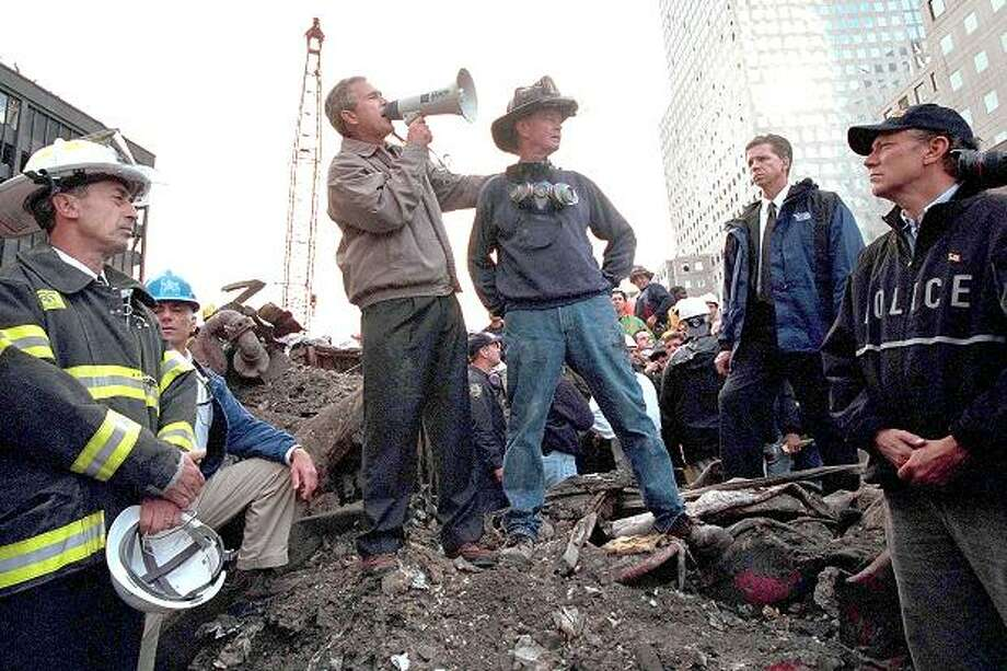 George W. Bush at ground zero three days after 9/11. Getty Images. / www.thetimes.co.uk
