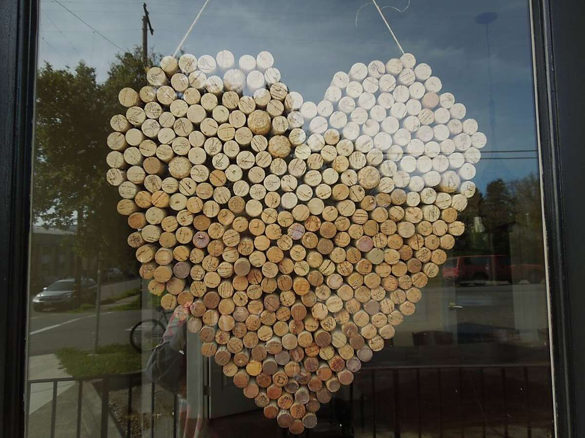 The heart made of wine corks hangs in the Paul Mathew tasting room.