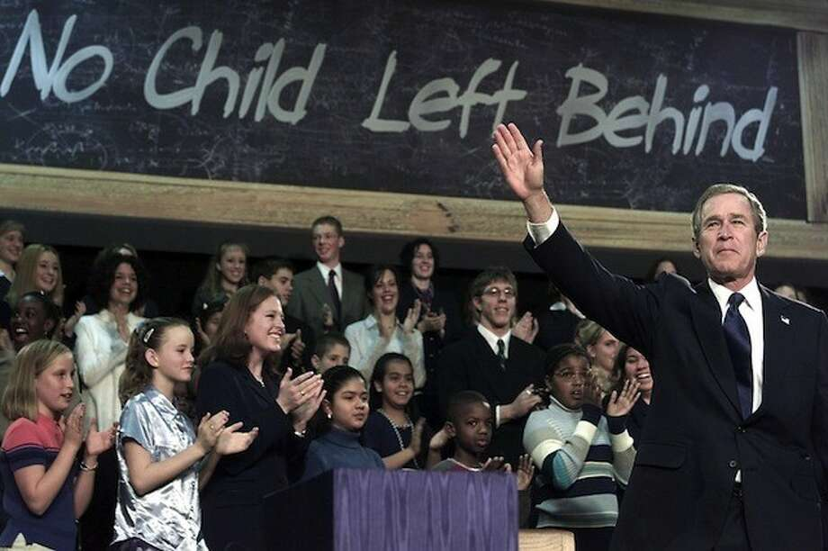 "George W. Bush signs ""No Child Left Behind\"" into law. Getty Images."