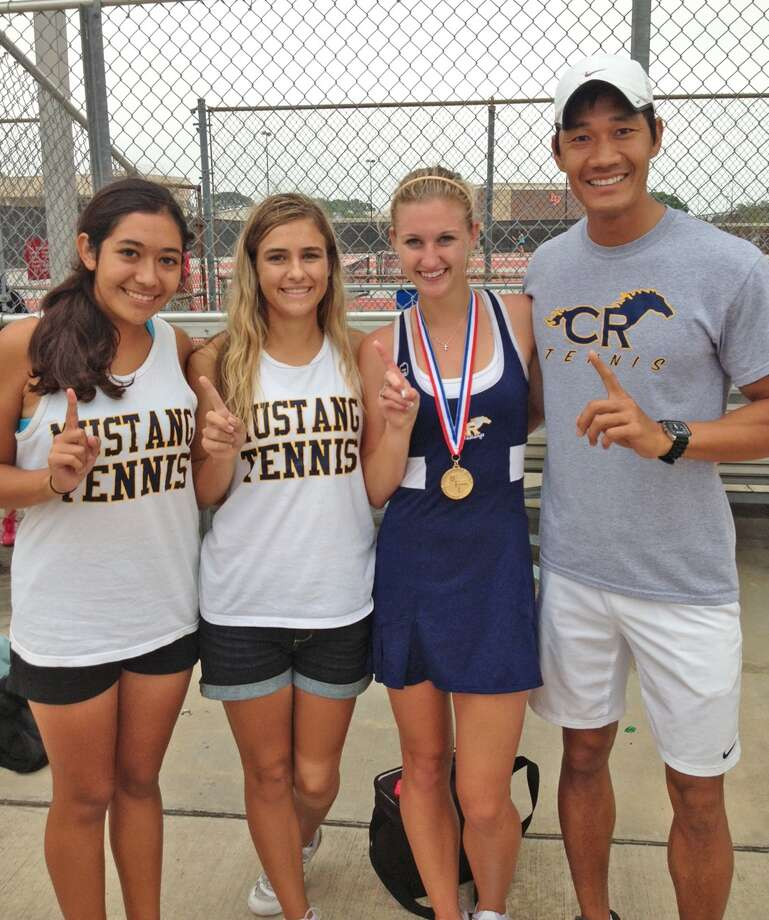 Cy Ranch senior and 2013 UIL Tennis State Tournament qualifier Courtney Anderson (third from left with Class 5A Region III gold medal) is glad to have the support of teammates like sophomore Daniela Herrera (far left) and senior Savannah Smith, and Cy Ranch coach Minh Phan. (Courtesy Cy Ranch tennis/Minh Phan) Photo: Scott Hainline