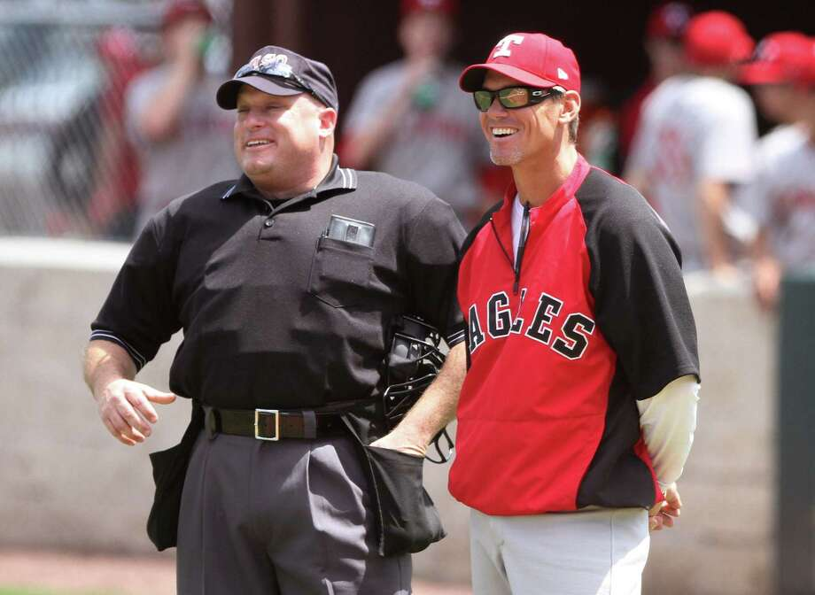 St. Thomas coach and former Houston Astro Craig Biggio laughs with an umpire before a high school baseball game against College Park on Saturday, April 6, 2013, in The Woodlands, Texas. (AP Photo/The Courier, Jason Fochtman) Photo: Jason Fochtman, MBR / Conroe Courier