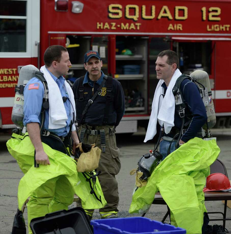 Firefighters Seth Coye, Saratoga Fire Department, left and Chris Franco, Maple Avenue Fire Company take a breather from their special suits during a hazmat drill at the Watervliet Arsenal Tuesday morning April 23, 2013 in Watervliet, N.Y.  Firefighting and EMS agencies from Albany, Rensselaer, Schenectady and Saratoga Counties as well as the Arsenal Police Department were all involved in the drill to test their emergency response capabilities.  (Skip Dickstein/Times Union) Photo: SKIP DICKSTEIN / 10022077A