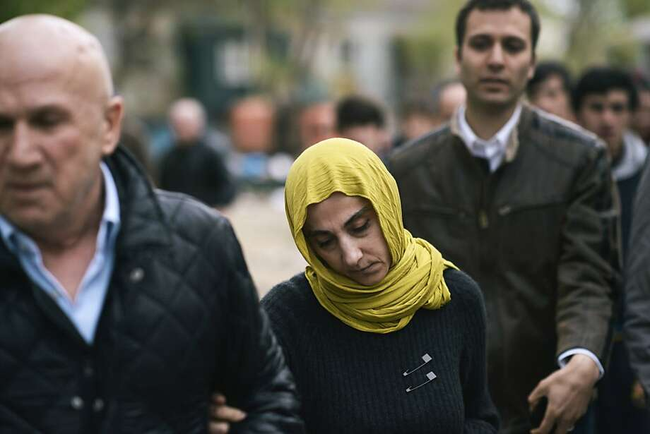 Zubeidat Tsarnaeva, the mother of the two suspects in the Boston bombing, walks with a relative surrounded by reporters near her home in Makhachkala, Russia, April 23, 2013. The surviving suspect in the Boston Marathon bombings, who officials said admitted to a role in the attacks, was charged Monday with using a weapon of mass destruction and could face the death penalty. (Dmitry Kostyukov/The New York Times) Photo: Dmitry Kostyukov, New York Times