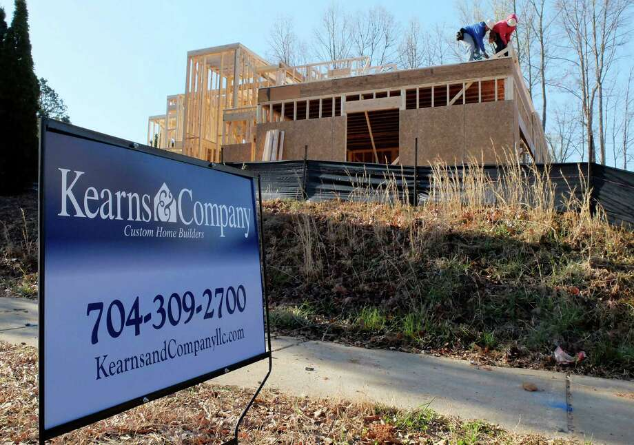 In this Friday, March 29, 2013, photo, a worker helps frame a new home under construction in Matthews, N.C. The Commerce Department reports on new-home sales for March on Tuesday, April 23, 2013. (AP Photo/Chuck Burton Photo: Chuck Burton