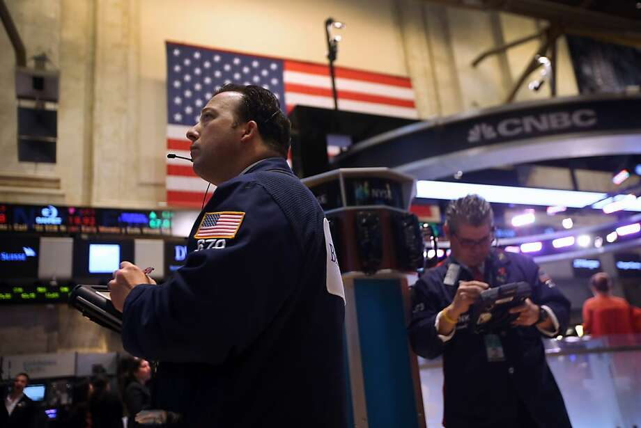 The stock market dropped sharply after the Associated Press' Twitter account was hacked and a false tweet announced that President Obama was injured in an attack at the White House. Photo: John Moore, Getty Images