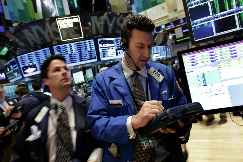 In this Tuesday, April 16, 2013, photo, Glenn Kessler, right, works on the floor of the New York Stock Exchange.World stock markets were mostly lower Tuesday April 23, 2013 after China's manufacturing growth slowed in April, adding to worries about the health of the world's second-largest economy.  (AP Photo/Richard Drew) Photo: Richard Drew