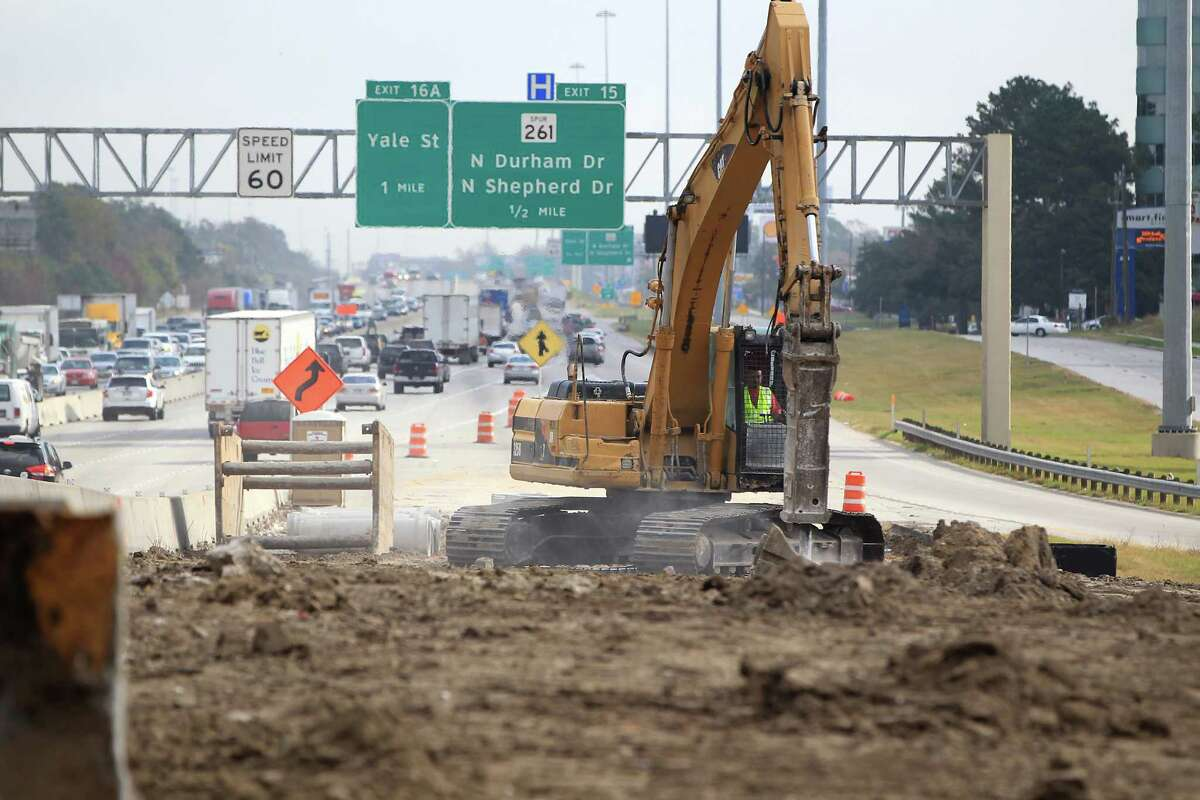 A bulldozer breaks up old concrete barriers to be recycled near the new exit ramp to Ella on 610 where construction is taking place for the 610 and US 290 interchange, Tuesday, Dec. 4, 2012, in Houston. ( Karen Warren / Houston Chronicle )
