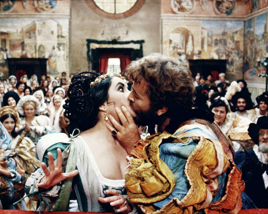 Elizabeth Taylor (1932-2011), British actress, and Richard Burton (1925-1984), British actor, both dressed in period costume, kissing in a publicity still issued for the film adaptation of William Shakespeare's 'The Taming of the Shrew', Italy, 1967. The film, directed by Franco Zeffirelli, starred Taylor as 'Katharina', and Burton as 'Petruchio'. Photo: Silver Screen Collection, Getty / Moviepix