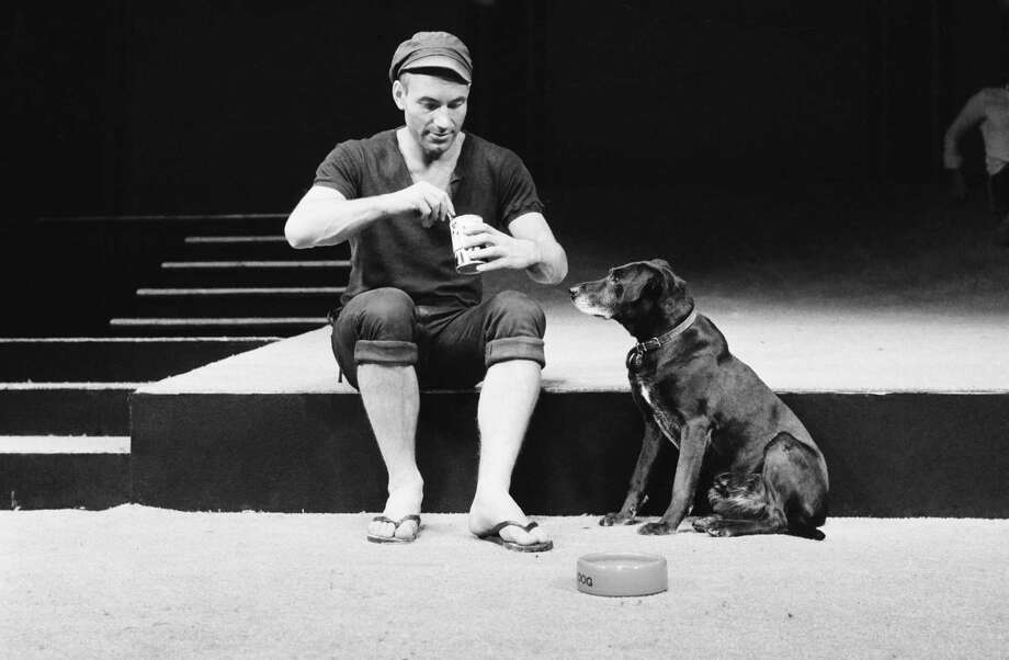 English actor Patrick Stewart as Launce, with his dog Crab, during rehearsals for Robin Phillips' production of 'Two Gentlemen Of Verona' for the Royal Shakespeare Company, London, 15th September 1970. The play opened at the Aldwych theatre, London, the following December. Photo: Evening Standard, Getty / 2010 Getty Images