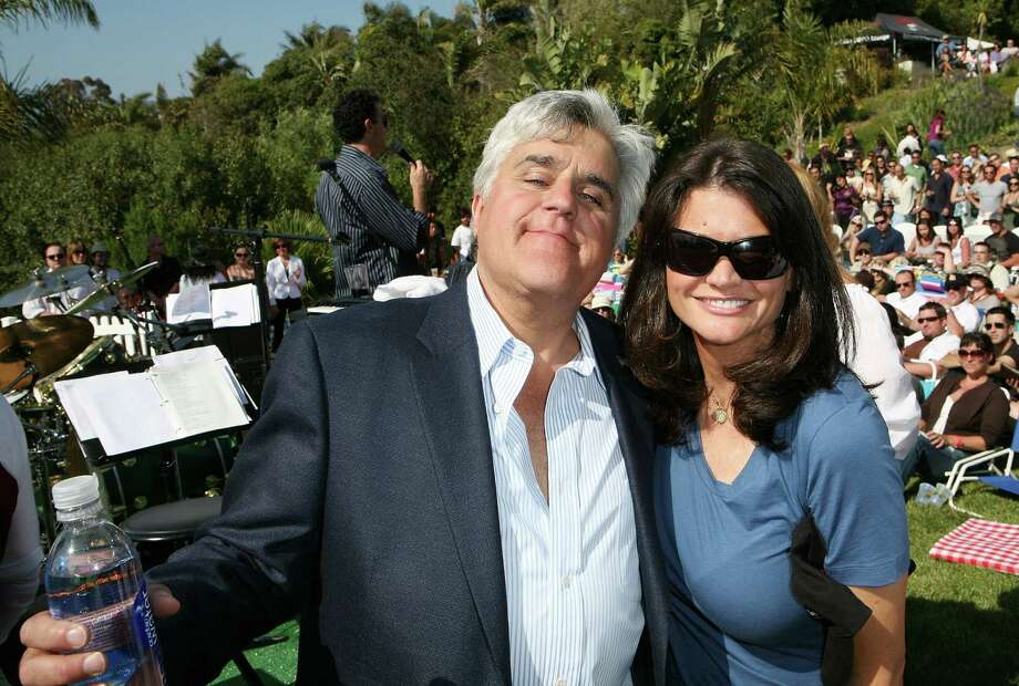 Comedian Jay Leno and host Lynette Carolla pose during the Shakespeare Festival/LA's Inaugural ShakesBEER Kegger Fundraising Event hosted by Adam and Lynette Carolla and Jay Leno in 2009 in Malibu, Calif. Photo: Ryan Miller, Getty / 2009 Ryan Miller