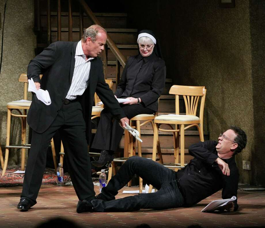"Cast members Kelsey Grammar (L) flogs Tom Hanks (R) on stage during the presentation of the Shakespeare Festival/LA 2009 Simply Shakespeare adaptation of ""The Comedy of Errors"" at the Geffen Playhouse on May 18, 2009 in Westwood, California. Photo: Ryan Miller, Getty / 2009 Ryan Miller"