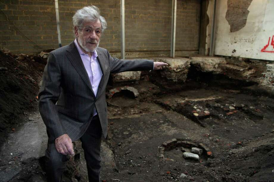 Sir Ian McKellen visits a site uncovered by the Museum of London, believed to be London first purpose-built playhouse, on March 19, 2009 in London, England. The location of this first purpose built playhouse, called The Theatre, constructed in 1576 by James Burbage, has been confirmed by Museum of London Archaeology following investigation of the site, a disused warehouse, in Shoreditch east London. Shakespeare wrote and performed at The Theatre between 1594-7 and it is thought that Romeo and Juliet was premiered there. Photo: Tim Whitby, Getty / 2009 Getty Images