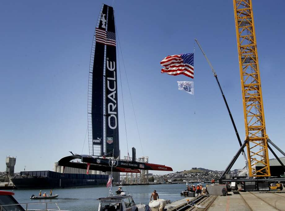 A large crane lifted the catamaran into the water next to the Oracle Team USA headquarters. To much fanfare, Oracle Team USA launched its new AC72 yacht Tuesday April 23, 2013 at their base headquarters near Marin Street in San Francisco, Calif.