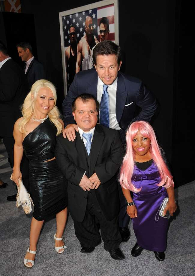 """Actor Mark Wahlberg poses with his costars Elaine Ganc, Donnie Davis and Ali Chapman at the \""""Pain & Gain\"""" - Los Angeles Premiere held at TCL Chinese Theatre on April 22, 2013 in Hollywood, California.  (Photo by Albert L. Ortega/WireImage)"""