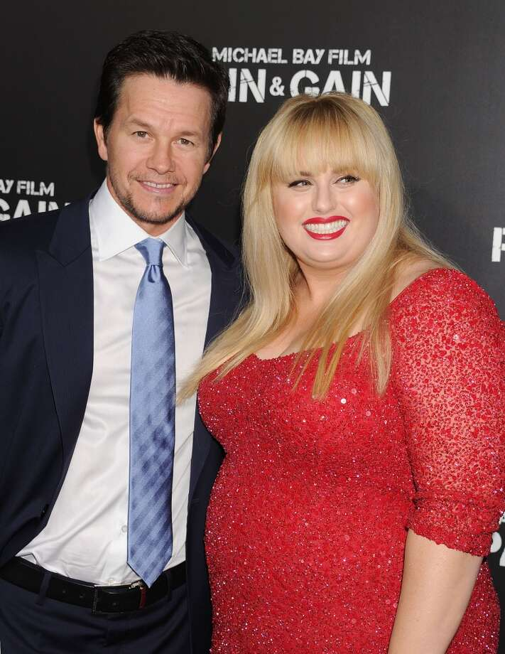 Actor Mark Wahlberg and Rebel Wilson attend the \'Pain & Gain\' premiere held at TCL Chinese Theatre on April 22, 2013 in Hollywood, California.(Photo by Jeffrey Mayer/WireImage)