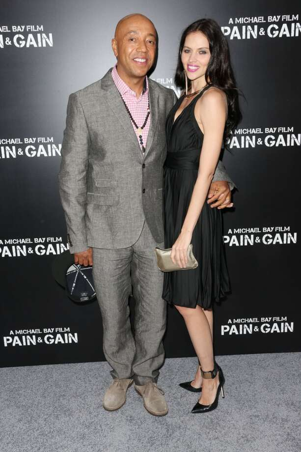 """HOLLYWOOD, CA - APRIL 22: Producer Russell Simmons (L) and Hana Nitsche attend the premiere of Paramount Pictures\' \""""Pain & Gain\"""" at the TCL Chinese Theatre on April 22, 2013 in Hollywood, California.  (Photo by Frederick M. Brown/Getty Images)"""