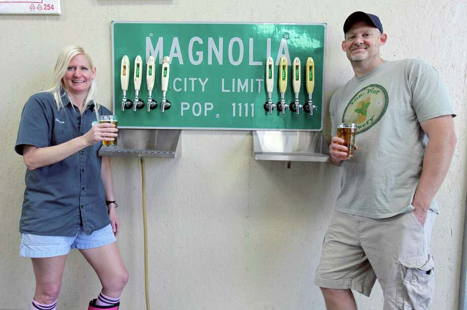 Lone Pint Brewery owners - and siblings - Heather Bolla and Trevor Brown, started tinkering with beer recipes in Brown's garage in Magnolia seven years ago. Their brewery is now open for weekend tours and beer sales. Photo: Eric Christian Smith, Freelance