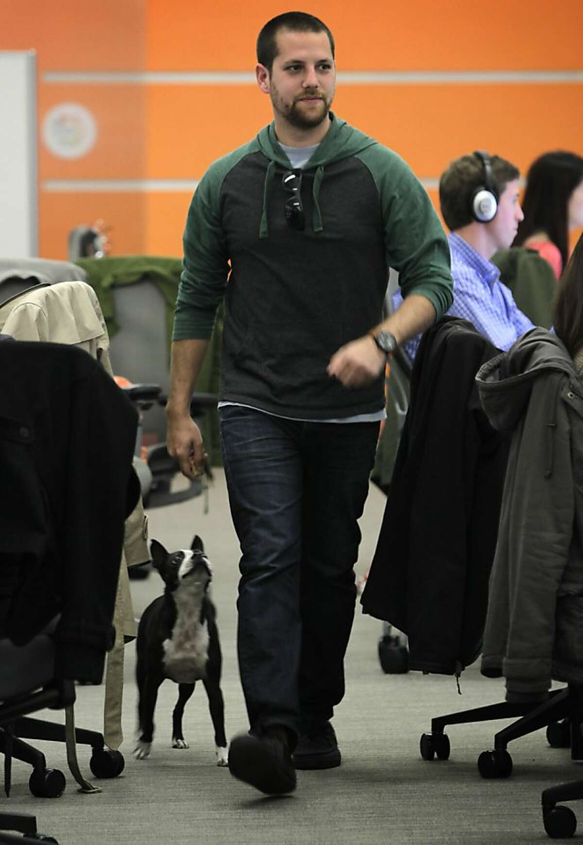Jared Surasky walks with his Boston terrier Boogie while on the job at his dog-friendly workplace at Eventbrite in San Francisco, Calif. on Thursday, April 11, 2013. Surasky has used rover.com, an online dog-sitting service to find homes for Boogie to stay in when Surasky travels out of town.