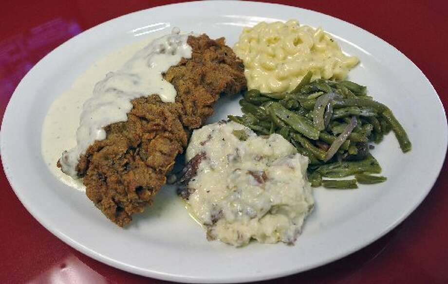 The Chicken Fried Steak plate that comes with green beans, macaroni and cheese, and homemade mashed potatoes at the Railway Cafe. Dave Ryan/cat5