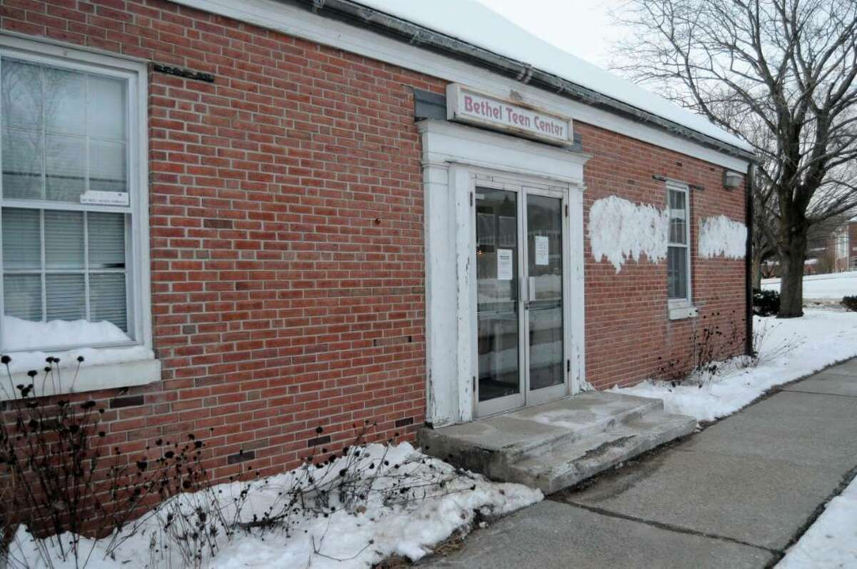The Bethel Teen Center building, rear entrance, on Wednesday, Dec. 23, 2009. The building was closed two years ago, because of asbestos. Instead of using grant money to get rid of the asbestos, Bethel's new Selectmen are considering other locations, because they may need to demolish the building to make way for more library parking.