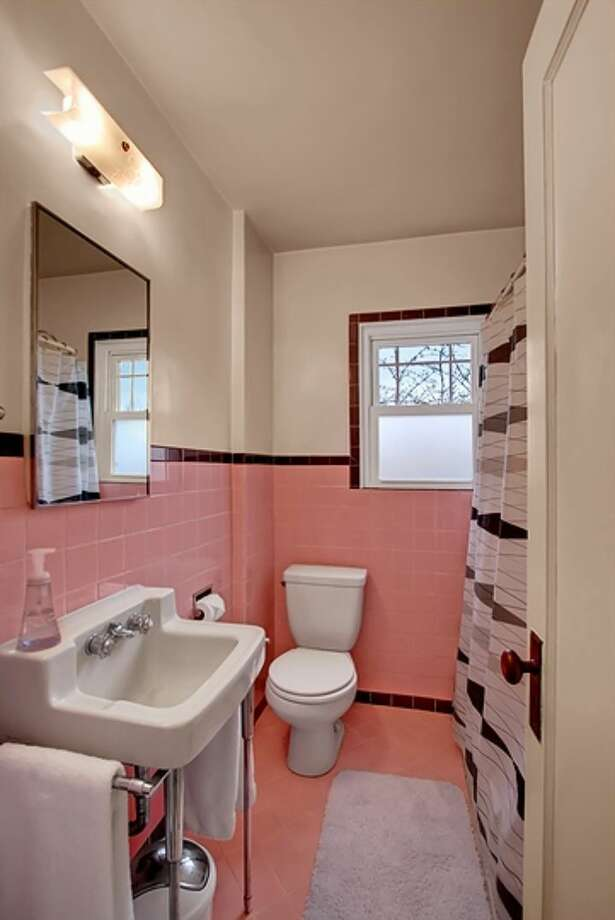 Bathroom of 11550 Fremont Ave. N. The 1,460-square-foot house, built in 1927, has three bedrooms, 1.5 bathrooms, a media room and a big back deck on a 7,200-square-foot lot. It's listed for $325,000. Photo: Courtesy Padraic Jordan/Windermere Real Estate