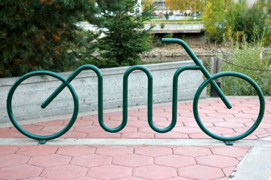 Art bike rack examples. Photos courtesy of the Oaks Historic District