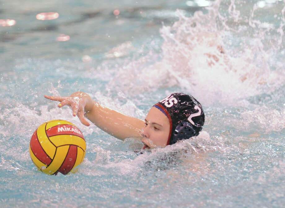 Paige Neary of Greenwich High School goes for the ball during water polo match against Staples High School at Greenwich, Tuesday, April 23, 2013. Photo: Bob Luckey / Greenwich Time