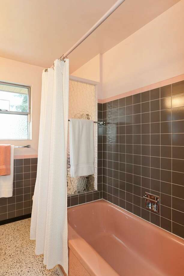 Bathroom of 10522 Evanston Ave. N. The 1,960-square-foot house, built in 1956, has three bedrooms, one bathroom, two fireplaces, a rec room and built-ins on a 6,300-square-foot lot. It's listed for $339,500, although a sale is pending. Photo: Courtesy Roberta Pletz, Windermere Real Estate