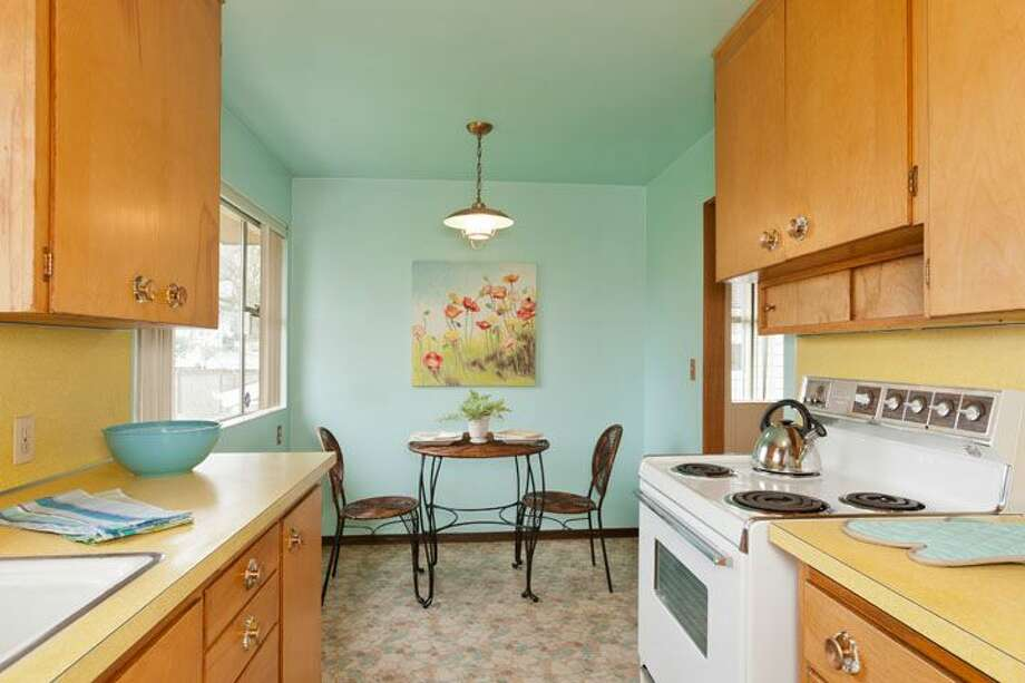 Kitchen of 10522 Evanston Ave. N. The 1,960-square-foot house, built in 1956, has three bedrooms, one bathroom, two fireplaces, a rec room and built-ins on a 6,300-square-foot lot. It's listed for $339,500, although a sale is pending. Photo: Courtesy Roberta Pletz, Windermere Real Estate