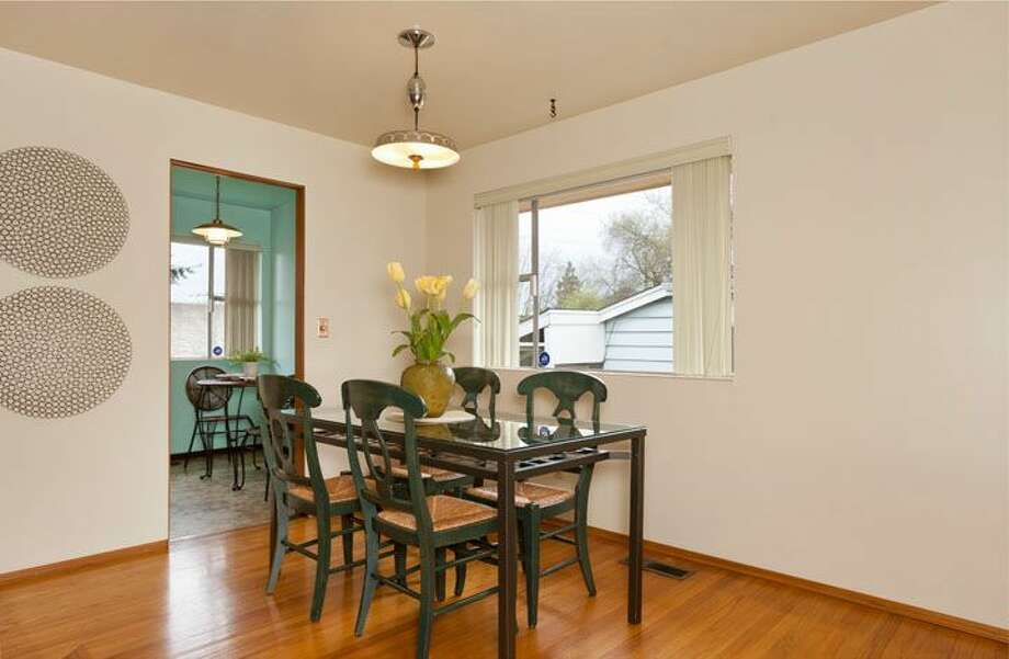 Dining room of 10522 Evanston Ave. N. The 1,960-square-foot house, built in 1956, has three bedrooms, one bathroom, two fireplaces, a rec room and built-ins on a 6,300-square-foot lot. It's listed for $339,500, although a sale is pending. Photo: Courtesy Roberta Pletz, Windermere Real Estate