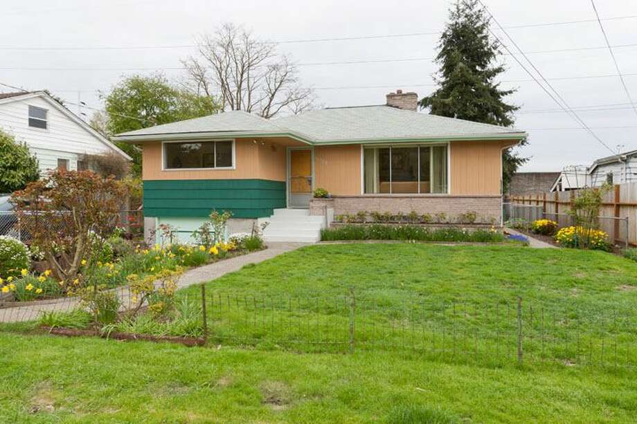 Moving up to $339,500, here's 10522 Evanston Ave. N. The 1,960-square-foot house, built in 1956, has three bedrooms, one bathroom, two fireplaces, a rec room and built-ins on a 6,300-square-foot lot. A sale is pending. Photo: Courtesy Roberta Pletz, Windermere Real Estate