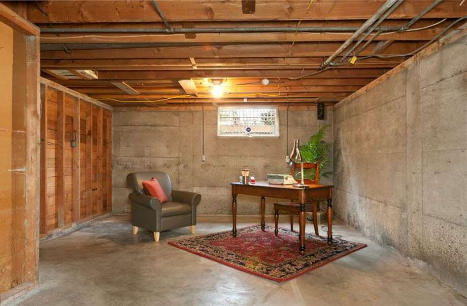 Basement of 10522 Evanston Ave. N. The 1,960-square-foot house, built in 1956, has three bedrooms, one bathroom, two fireplaces, a rec room and built-ins on a 6,300-square-foot lot. It's listed for $339,500, although a sale is pending. Photo: Courtesy Roberta Pletz, Windermere Real Estate