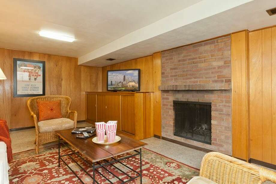 Rec room of 10522 Evanston Ave. N. The 1,960-square-foot house, built in 1956, has three bedrooms, one bathroom, two fireplaces and built-ins on a 6,300-square-foot lot. It's listed for $339,500, although a sale is pending. Photo: Courtesy Roberta Pletz, Windermere Real Estate