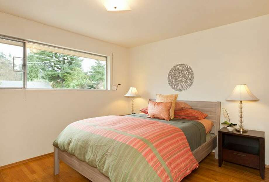 Bedroom of 10522 Evanston Ave. N. The 1,960-square-foot house, built in 1956, has three bedrooms, one bathroom, two fireplaces, a rec room and built-ins on a 6,300-square-foot lot. It's listed for $339,500, although a sale is pending. Photo: Courtesy Roberta Pletz, Windermere Real Estate